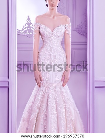 Beautiful woman in amazing crystal wedding dress - stock photo