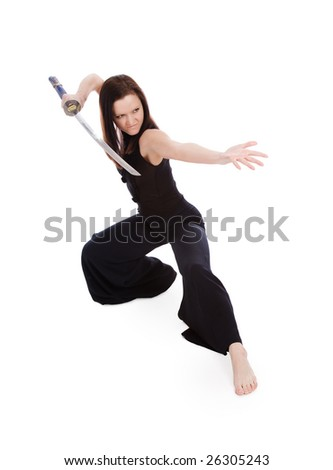Beautiful woman in an aggressive posture with a sword on a white background