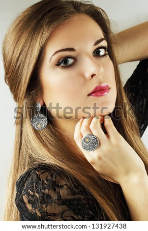 Beautiful woman in an old ethnic silver jewelry - stock photo