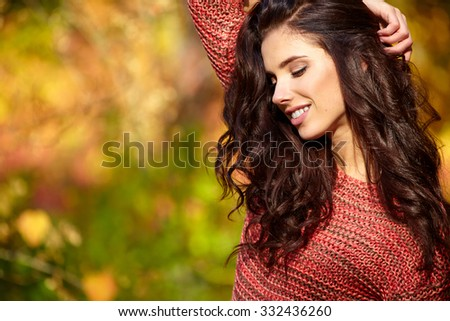Beautiful  woman in autumn park - stock photo