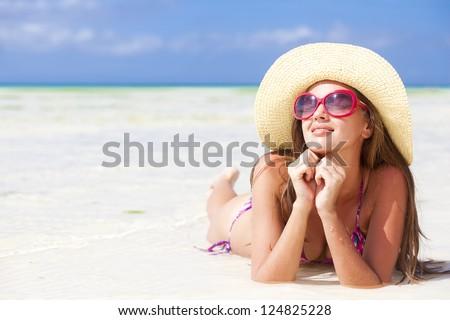 beautiful woman in bikini and straw hat on tropical boracay beach - stock photo