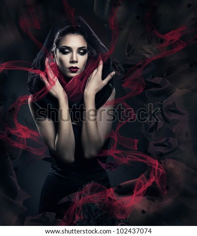 beautiful woman in black hood with abstract fabric - stock photo
