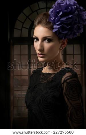 Beautiful woman in black lace dress - stock photo