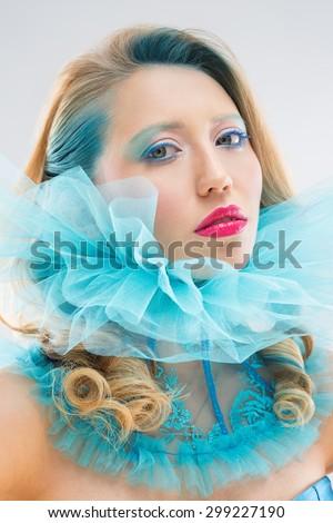 Beautiful woman in blue collar - stock photo
