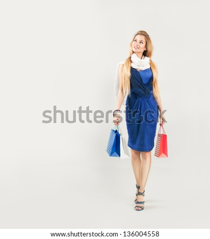 Beautiful Woman in Blue Dress with Shopping Bags - stock photo