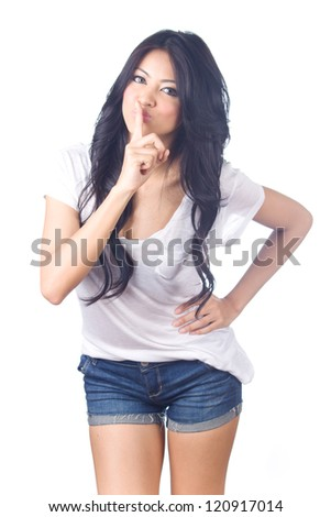 Beautiful woman in blue jeans and white shirt with silence sign isolated on white background. - stock photo