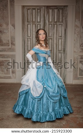 Beautiful woman in blue long medieval dress  - stock photo
