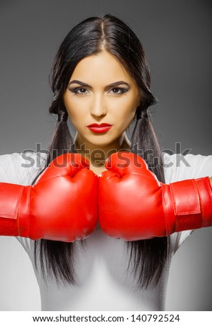 beautiful woman in boxing gloves - stock photo