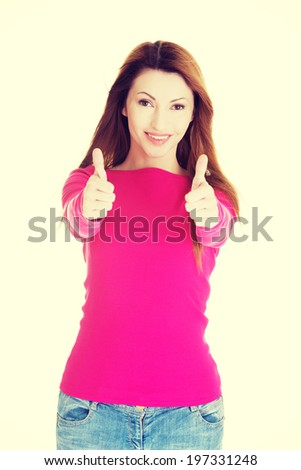 Beautiful woman in casual clothes gesturing thumbs up. - stock photo