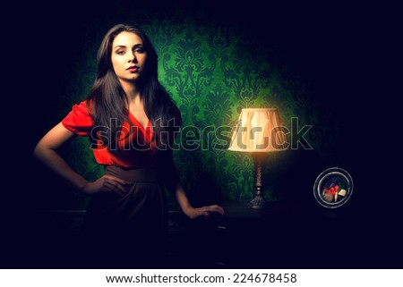 Beautiful woman in classy clothes in green vintage room. Strong shadows, vignette. Classy and sensual. Retro-luxury. Old style interior. Classic - stock photo