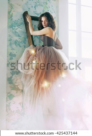 Beautiful woman in designed wedding dress - stock photo