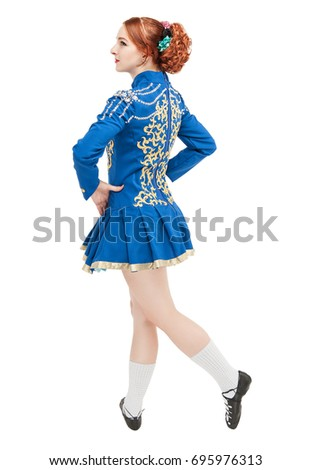 Beautiful woman in dress for Irish dance isolated on white