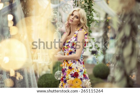 Beautiful woman in dress of flowers - stock photo