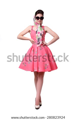 Beautiful woman in dress pin-up posing on a white background. - stock photo