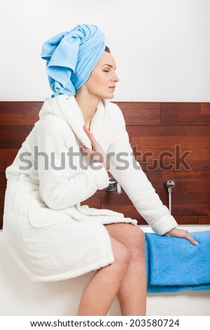 Beautiful woman in dressing-gown relaxing after bath