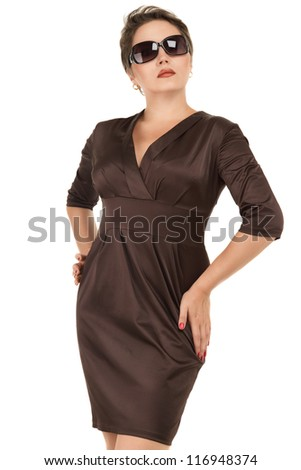 Beautiful woman in elegant dress against white background - stock photo