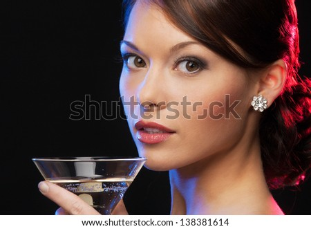 beautiful woman in evening dress with cocktail