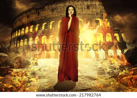 Beautiful woman in fire. Priestess praying to god. Rome. Fantasy woman. Book cover - stock photo