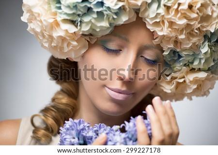 Beautiful woman in flowers - stock photo
