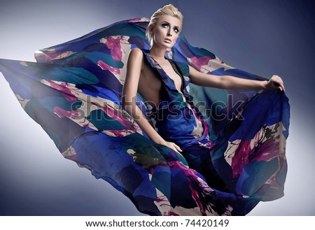 Beautiful woman in gorgeous dress - stock photo