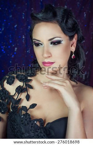 Beautiful woman in gorgeous dress isolated on black background.  - stock photo