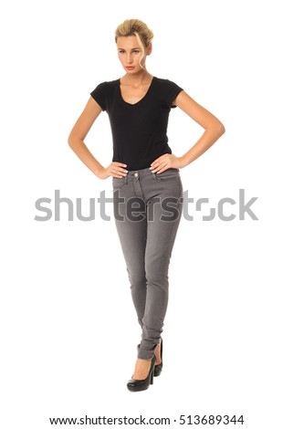 Beautiful woman in gray jeans with bun blonde hair isolated