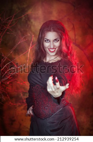 Beautiful woman in halloween style beckoning finger - stock photo