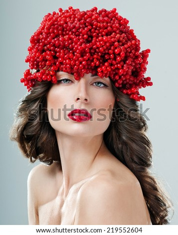 beautiful woman in hat of red berries - stock photo