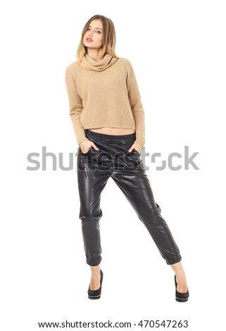 Beautiful woman in leather pants over white