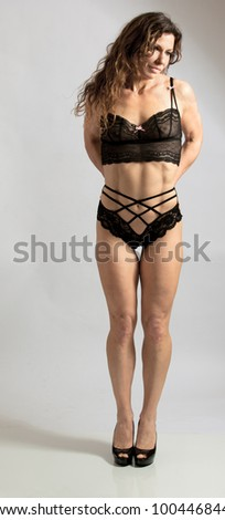 Beautiful woman in lingerie waiting - stock photo