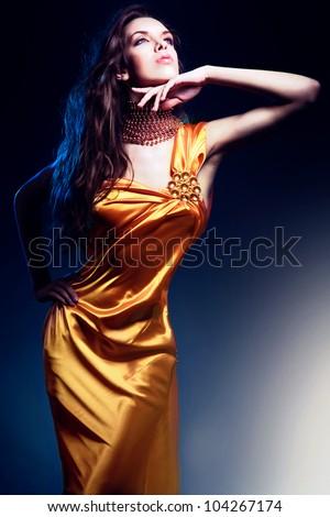 beautiful woman in long dress - stock photo