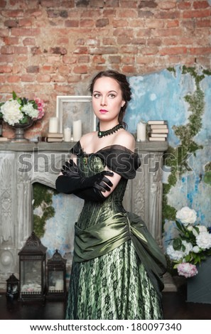 Beautiful woman in long medieval dress  - stock photo