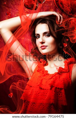 beautiful woman in love in red dress around fabric