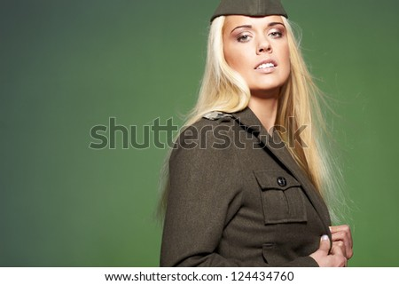 Beautiful woman  in military clothes - stock photo