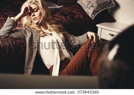 Beautiful woman in modern bedroom - stock photo