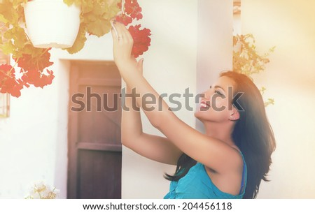 Beautiful woman in morning sun - stock photo