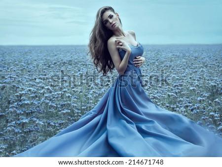 Beautiful woman in night dress outdoor  - stock photo