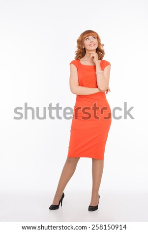 Beautiful woman in orange dress on white - stock photo