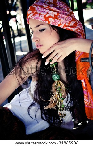 beautiful woman in oriental clothes, outdoor portrait - stock photo