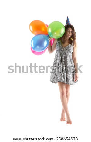 Beautiful woman in party hat with colorful balloons - stock photo