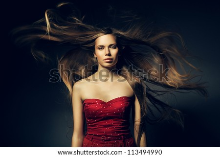 beautiful woman in red and long windy hair