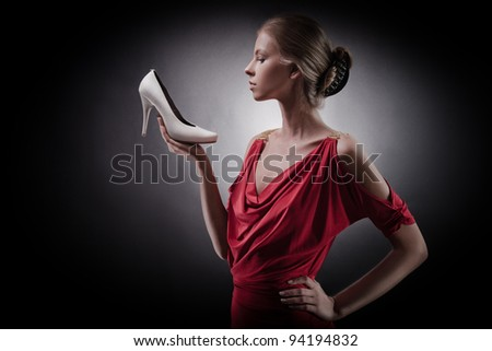 Beautiful woman in red dress. Girl and shoe - stock photo