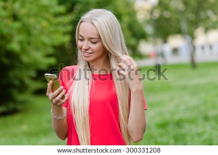 Beautiful woman in red dress with telephone