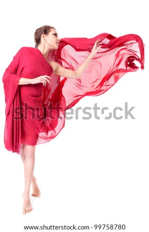 Beautiful woman in red flying dress isolated on white background - stock photo
