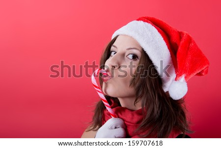 Beautiful woman in Santa Claus clothes over red  background. - stock photo