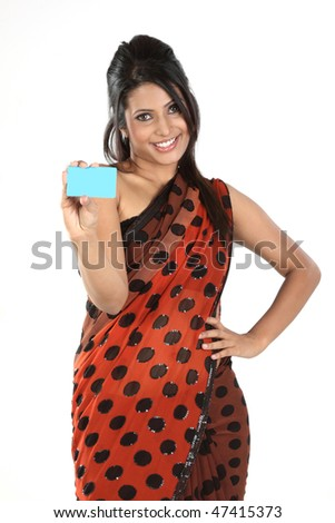 Beautiful woman in sari holding blue blank card - stock photo
