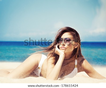 Beautiful woman in sexy swimsuit on the beach - stock photo