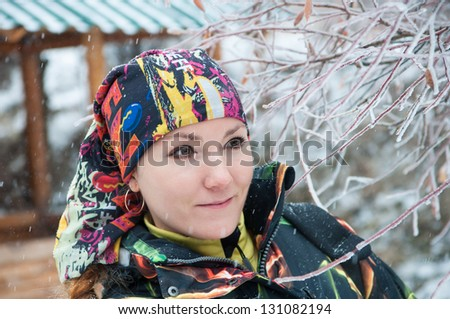 Beautiful woman in ski suit in snowy winter outdoors,  Almaty, Kazakhstan, Asia - stock photo