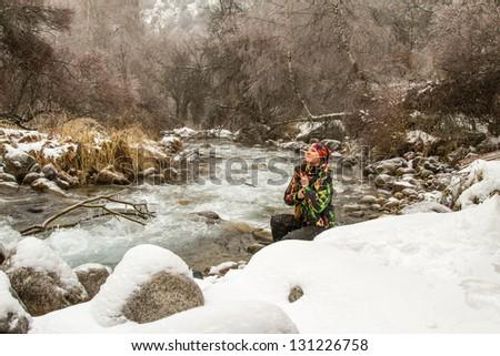 Beautiful woman in ski suit in snowy winter outdoors,  Almaty, Kazakhstan, Asia - stock photo