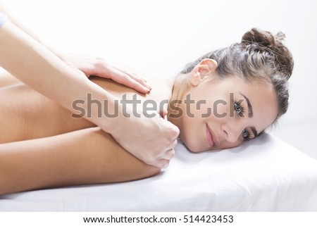 Beautiful woman in spa centar enjoying the massage. Woman in spa salon